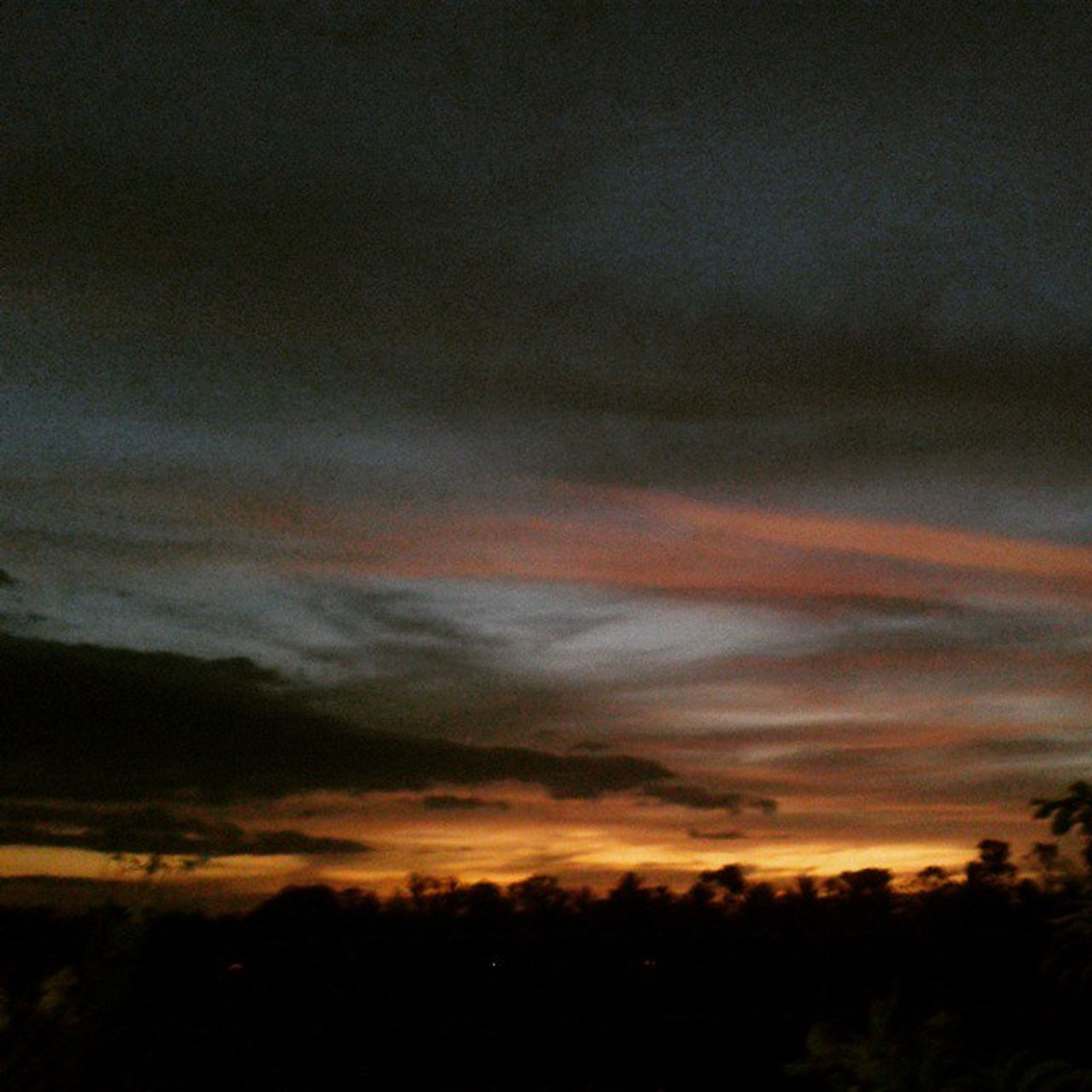 sunset, silhouette, sky, scenics, beauty in nature, tranquil scene, tranquility, cloud - sky, orange color, nature, idyllic, dramatic sky, tree, landscape, cloudy, dusk, low angle view, cloud, weather, outdoors