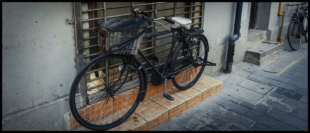 bicycle, stationary, no people, day, transportation, outdoors, architecture, bicycle rack