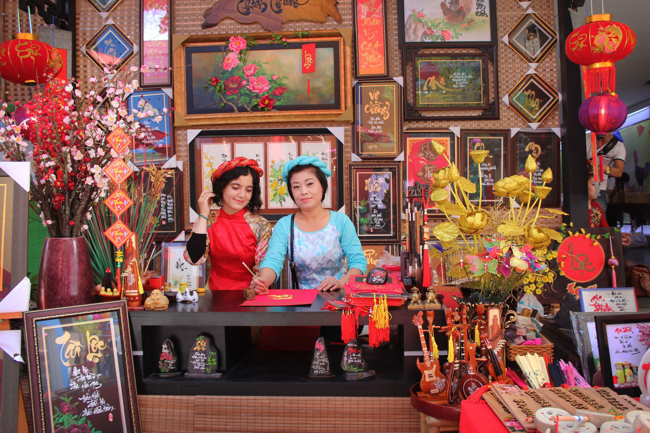 Adults Only Art And Craft Creativity Decoration Entrepreneur Flower Looking At Camera Multi Colored Only Women Owner People People Watching Portrait Pride Small Business Tet 2017 Tet Holiday Tet In Saigon Tetholiday Two People Tết Vietnam Vietnamese Vietnamesegirl Women