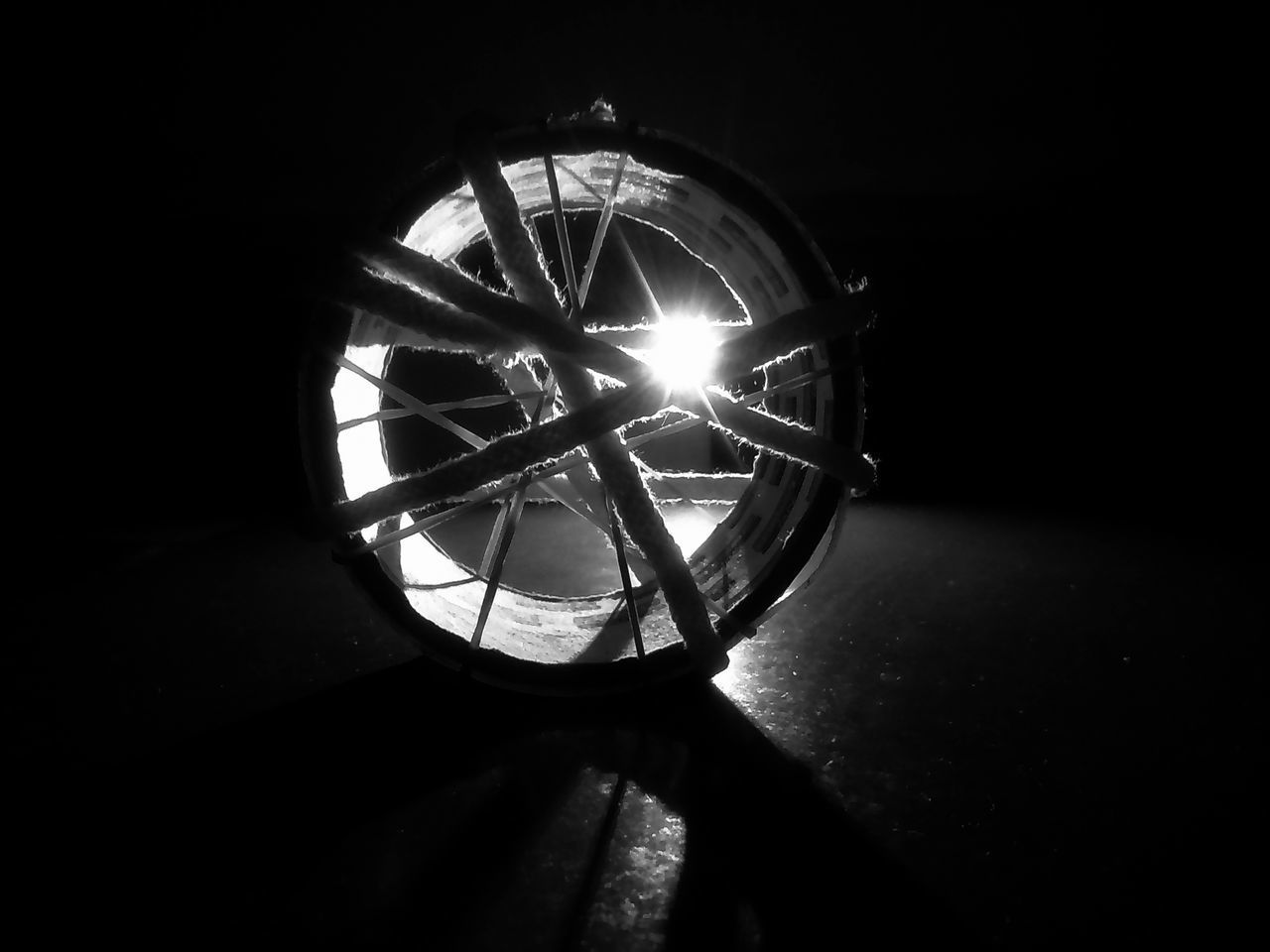 Circle No People Night Indoors  Tire Close-up Black Background Mobilephotography Silhouette EyeEmNewHere Camera Light Source Black Background Focus On Foreground Dark Cutlight