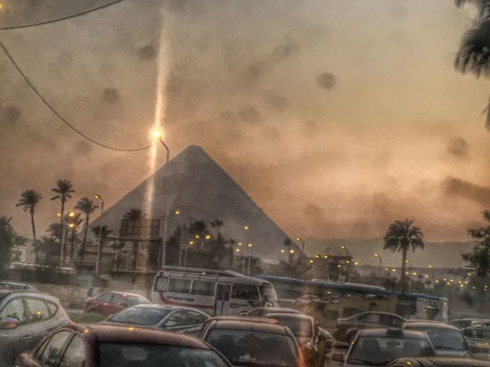 The great pyramids with the the daily Traffic jam of cairo Everydayinegypt Pyramid EmEyeNewHere Car Transportation Land Vehicle Built Structure Mode Of Transport Architecture Sky