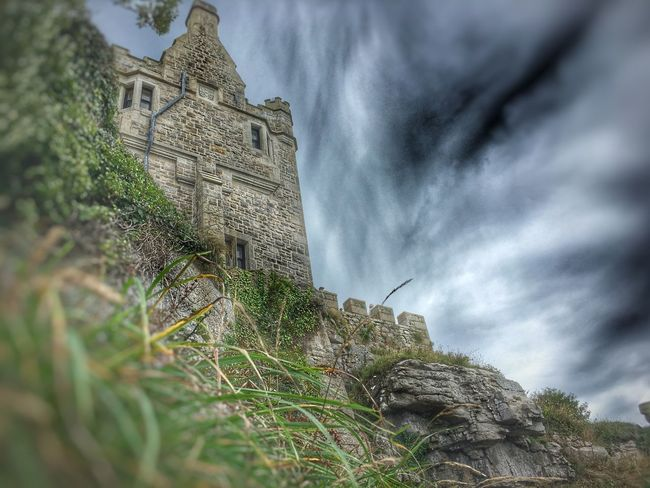St Michaels mount Architecture Built Structure Low Angle View Building Exterior Spirituality Focus On Background Selective Focus Place Of Worship History Sky Travel Destinations Cloud - Sky Outdoors Church Famous Place Tourism Day The Past Green Color Nature TakeoverContrast