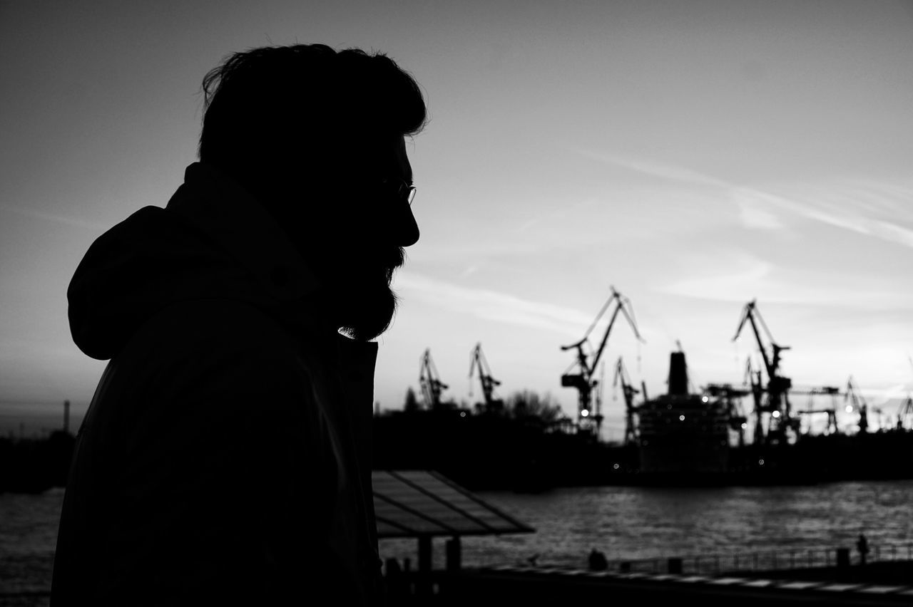 Hamburg Portrait Portrait Photography Blackandwhite Photography Blackandwhite Real People One Person Water Silhouette Sky Outdoors Real Photography Lifestyles City Life Monochrome Hafencity Eyeemphoto Man Urban Urban Skyline Waterfront Cityscapes Sony A6000