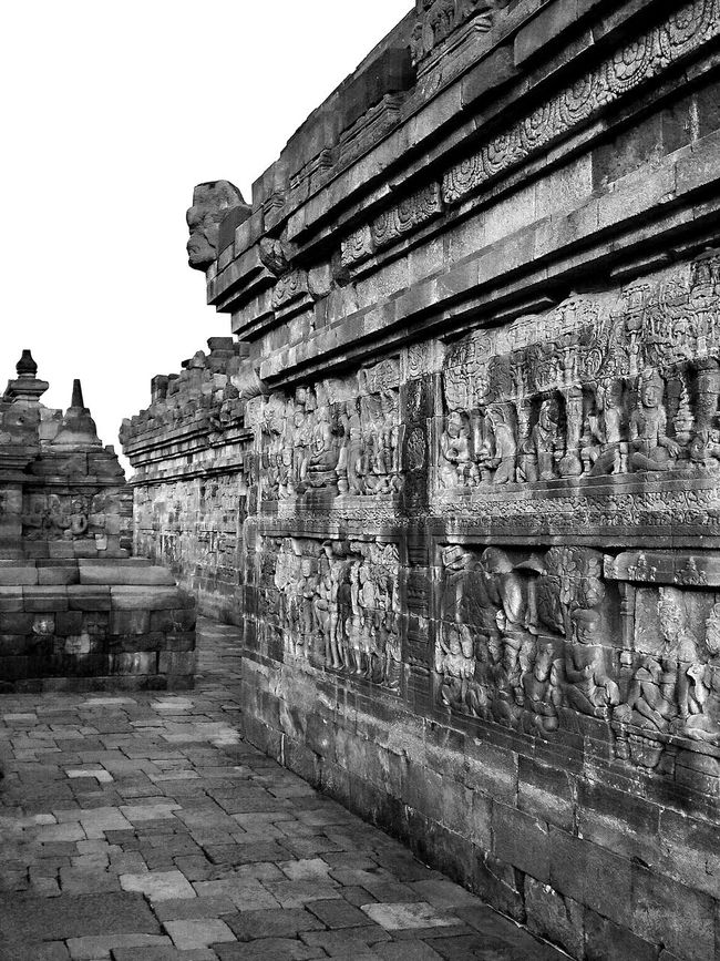 Lorong Borobudur Temple INDONESIA .. Monochrome Photography edition Temple Ancient History Famous Place Travel Destinations Ancient Civilization Stone Material Relief Architecture Art And Craft Textures And Surfaces Black And White Photography Beauty In Nature Black And White Tranquil Scene Street Photography TakeoverContrast Black & White Tourism Temple Architecture Statue
