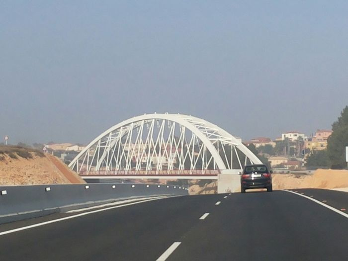 Passing this bridge by I always wanted to make a photo. New Bridge Modern Bridge White Bridge Metal Structure Bridge Warm Winter Day Road On The Road New Road  Urban Landscape SPAIN Manises Road Perspective Architectural Encounters Feel The Journey On The Way
