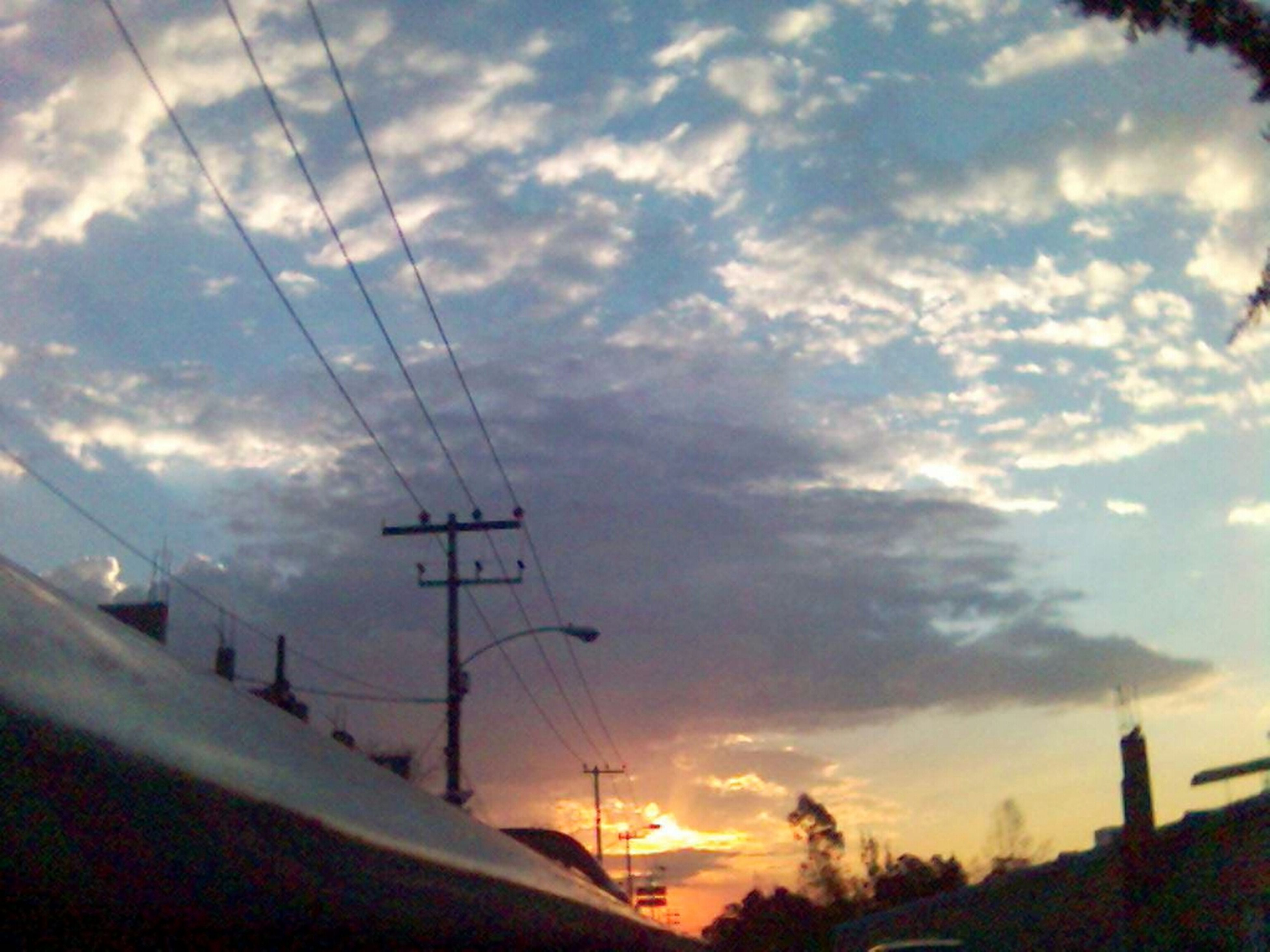 power line, sky, sunset, electricity pylon, cloud - sky, electricity, cable, power supply, connection, beauty in nature, silhouette, scenics, cloud, nature, transportation, cloudy, tranquil scene, tranquility, tree, low angle view