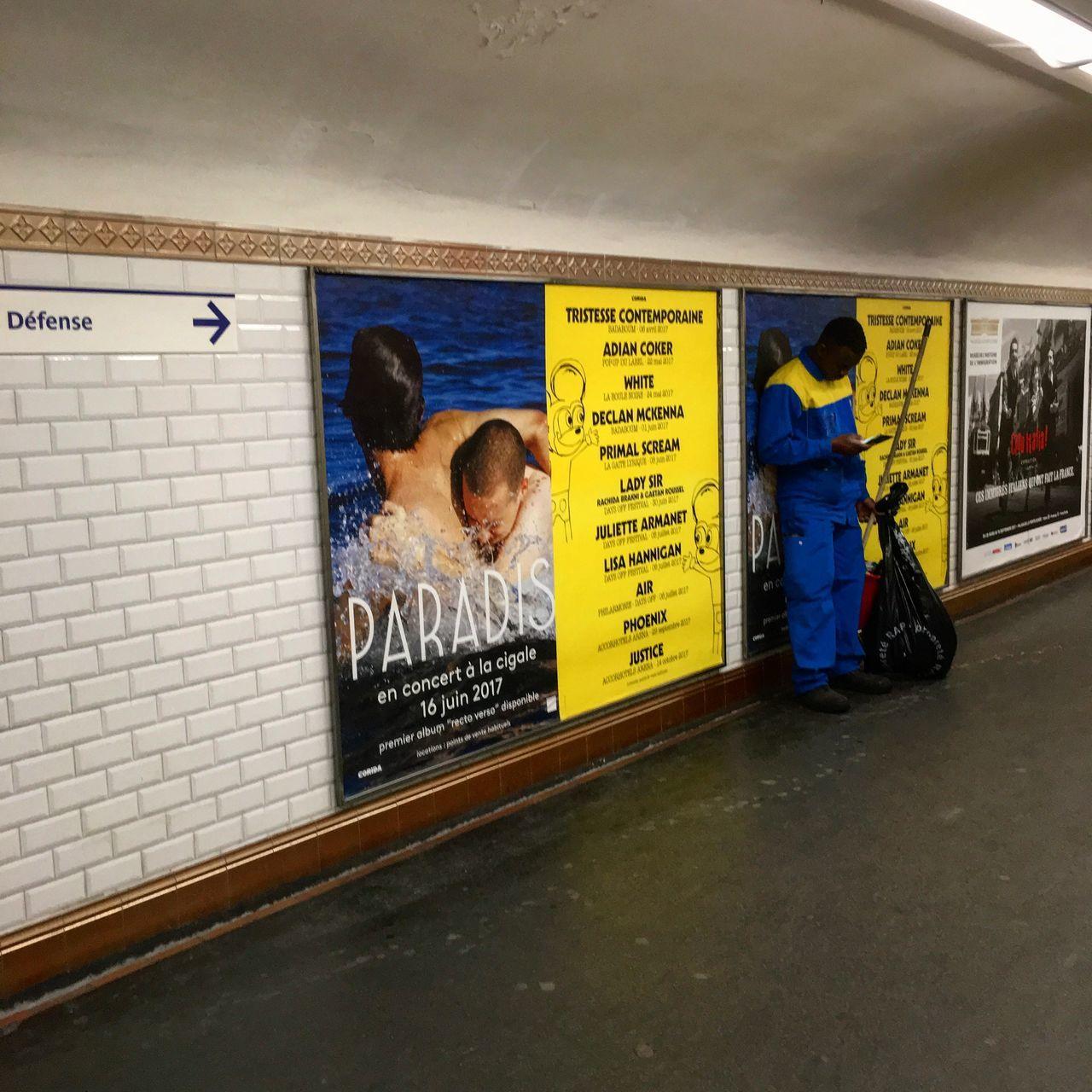 Yellow and blue Blackandwhite Cleaner Corridor Man Standing Metro Posters Subway Tiles Wall Yellow