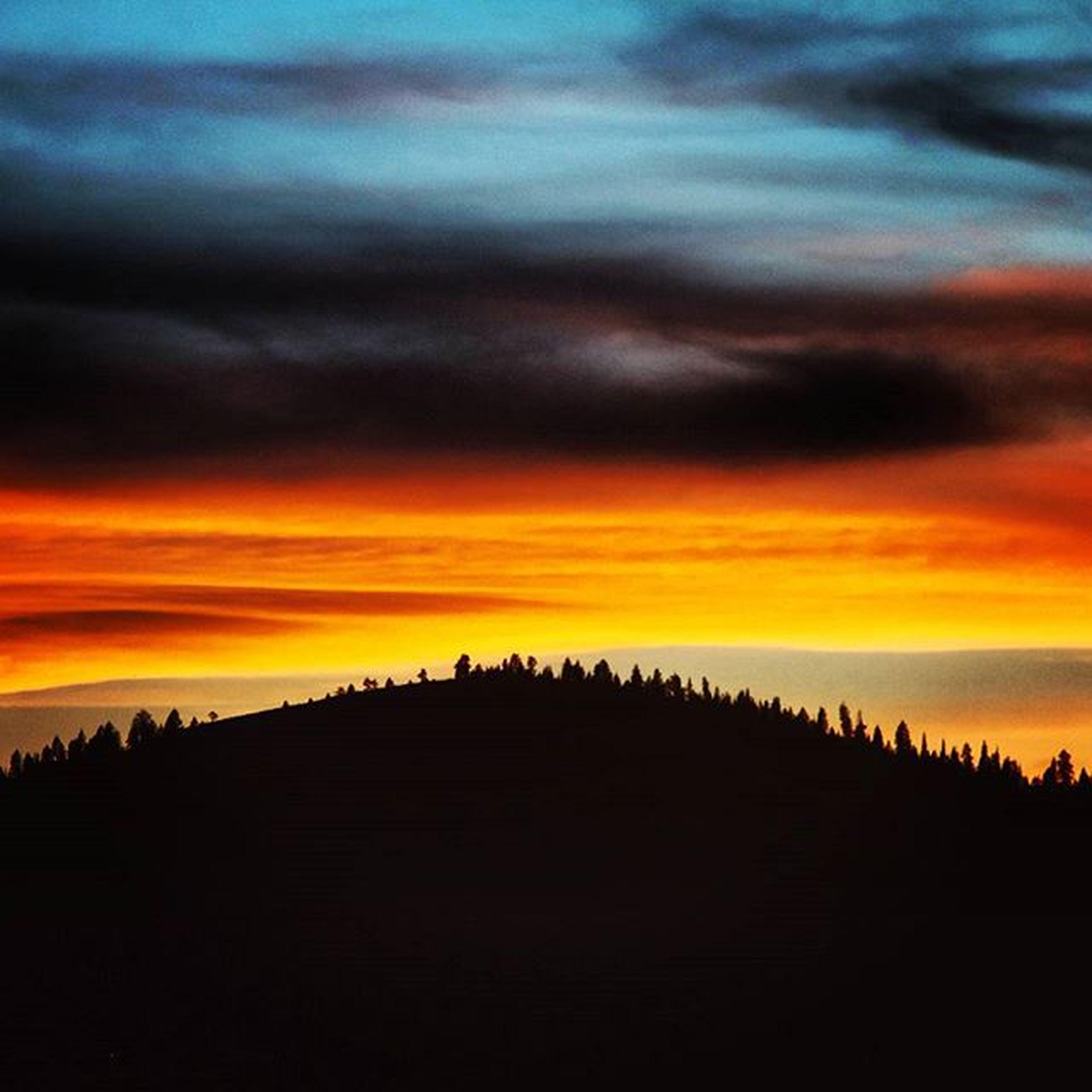 sunset, silhouette, orange color, scenics, sky, tranquil scene, tranquility, beauty in nature, nature, cloud - sky, idyllic, dramatic sky, landscape, dusk, cloud, outdoors, majestic, dark, no people, moody sky