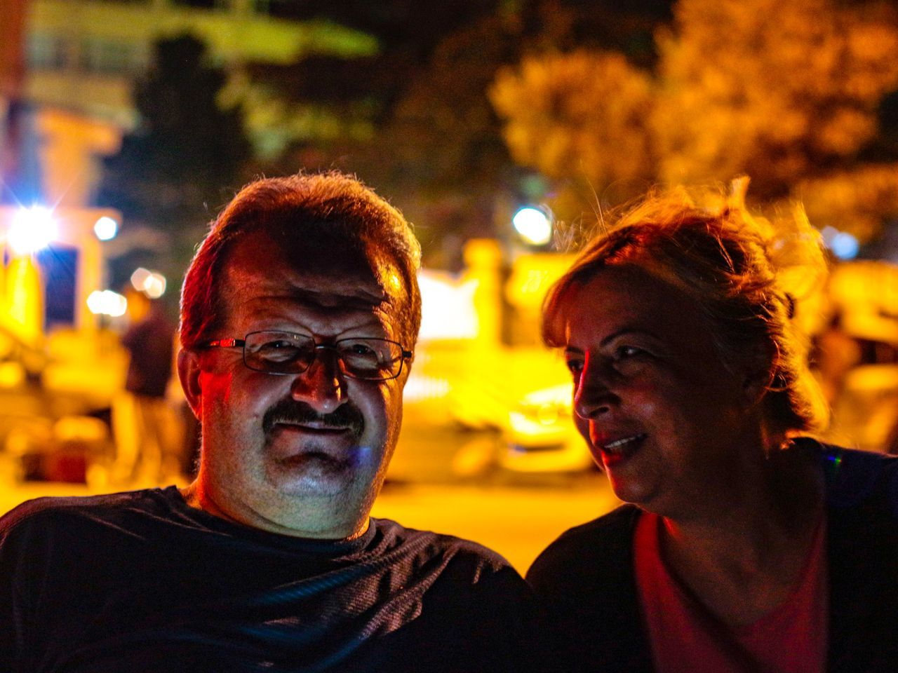 EyeEm Selects EyeEmNewHere Two People Night Illuminated Real People Togetherness Focus On Foreground Love Mature Men Mature Adult Lifestyles Bonding Men Headshot Young Adult Eyeglasses  Portrait Young Women Indoors  Close-up Adult