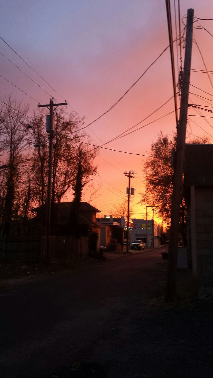 cable, power line, electricity pylon, electricity, power supply, sunset, sky, transportation, no people, built structure, tree, telephone line, fuel and power generation, dusk, road, outdoors, technology, architecture, building exterior, nature, city, day