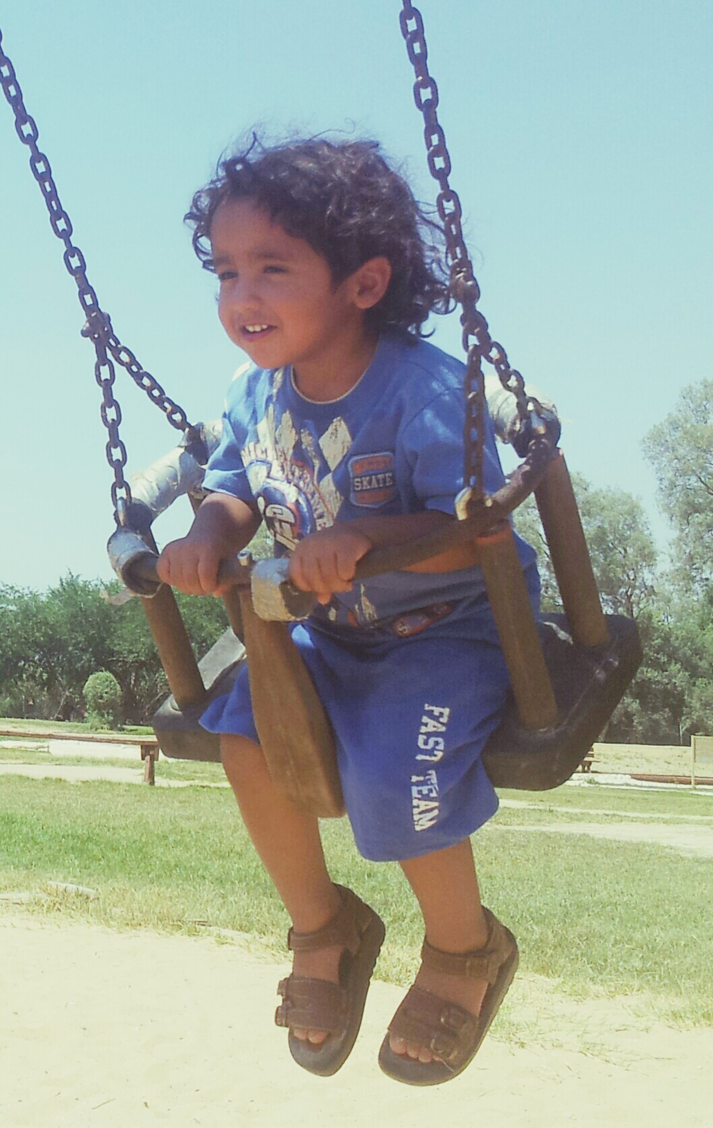 childhood, person, lifestyles, leisure activity, full length, casual clothing, fun, elementary age, happiness, swing, boys, playing, playground, enjoyment, front view, playful, smiling, girls