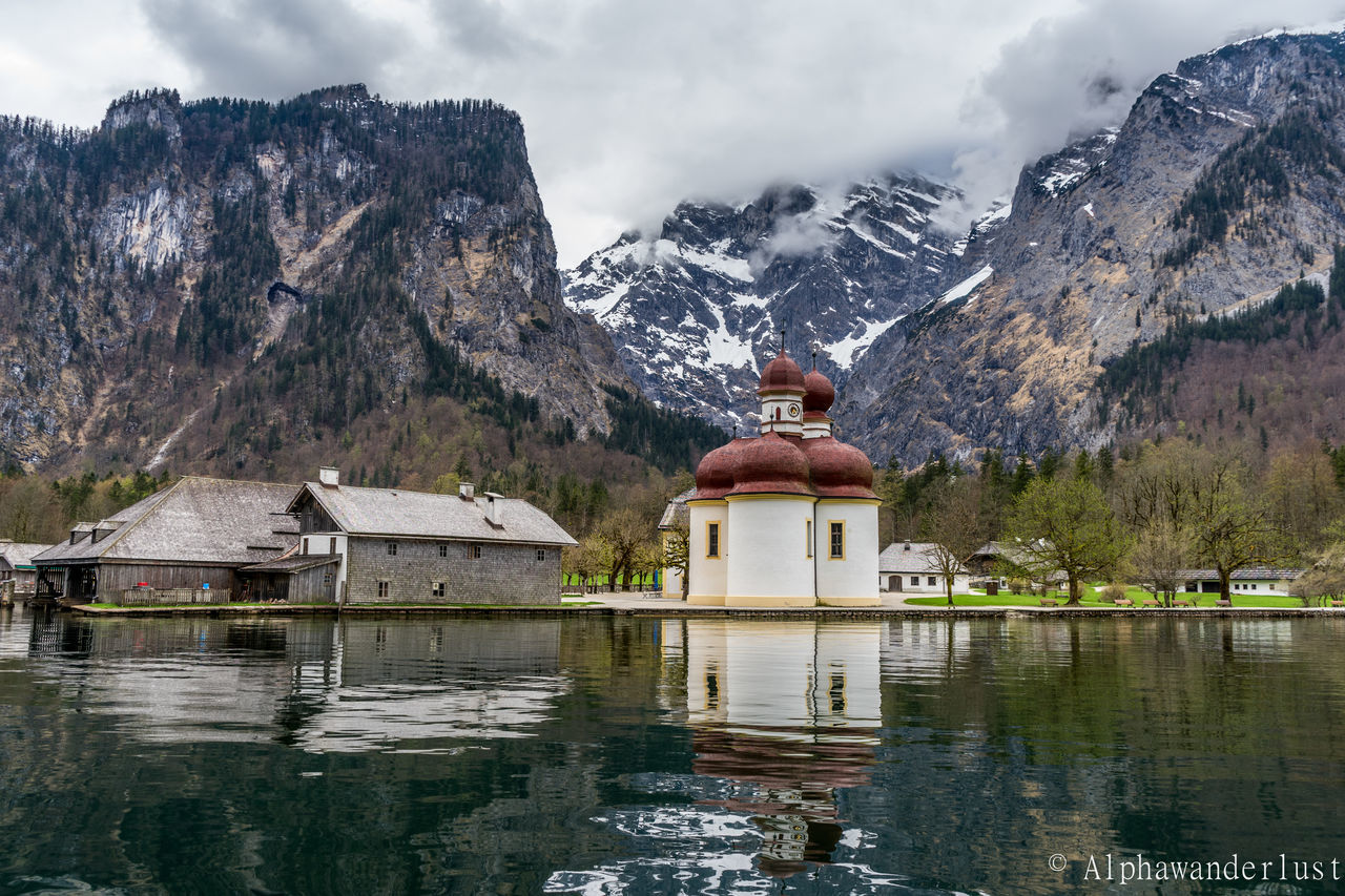 Beauty In Nature Boat Dock Built Structure Church Cloudy Germany Königssee Lake Mountain Nature No People Outdoors Reflection Snowcapped Mountain St Bartholomew Tourist Attraction  Tranquil Scene Tranquility Travel Travel Destinations Travel Photography Water