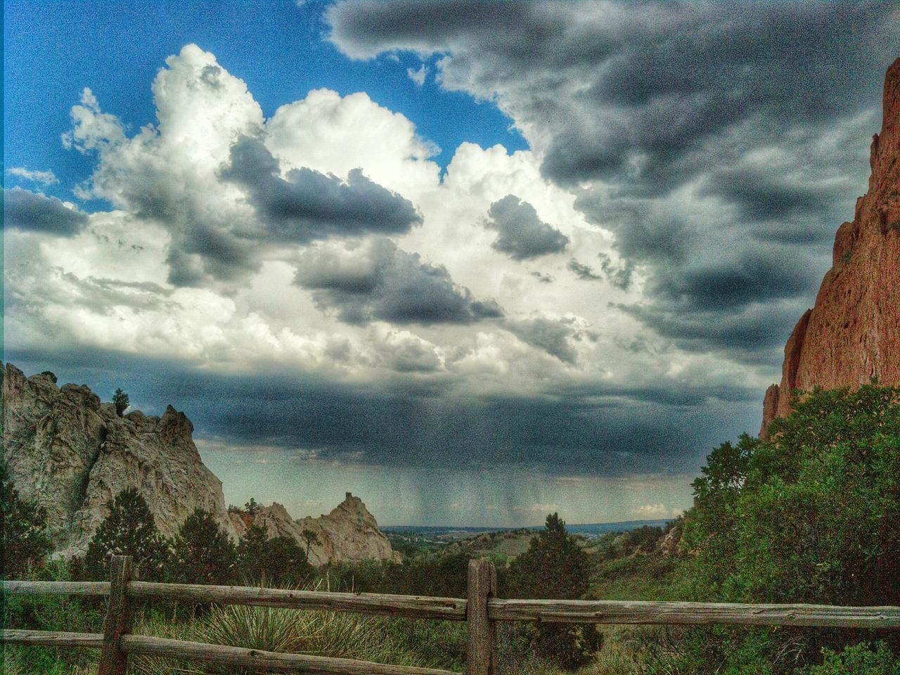 Storm Clouds Stormy Weather Clouds Garden Of The Gods Colorado Colorado Springs Rain Clouds Rain Colorful Fences Wood Fence Dramatic Sky Turmoil Summer Storms Samsungphotography Samsung Galaxy Note 3Mobilephotography