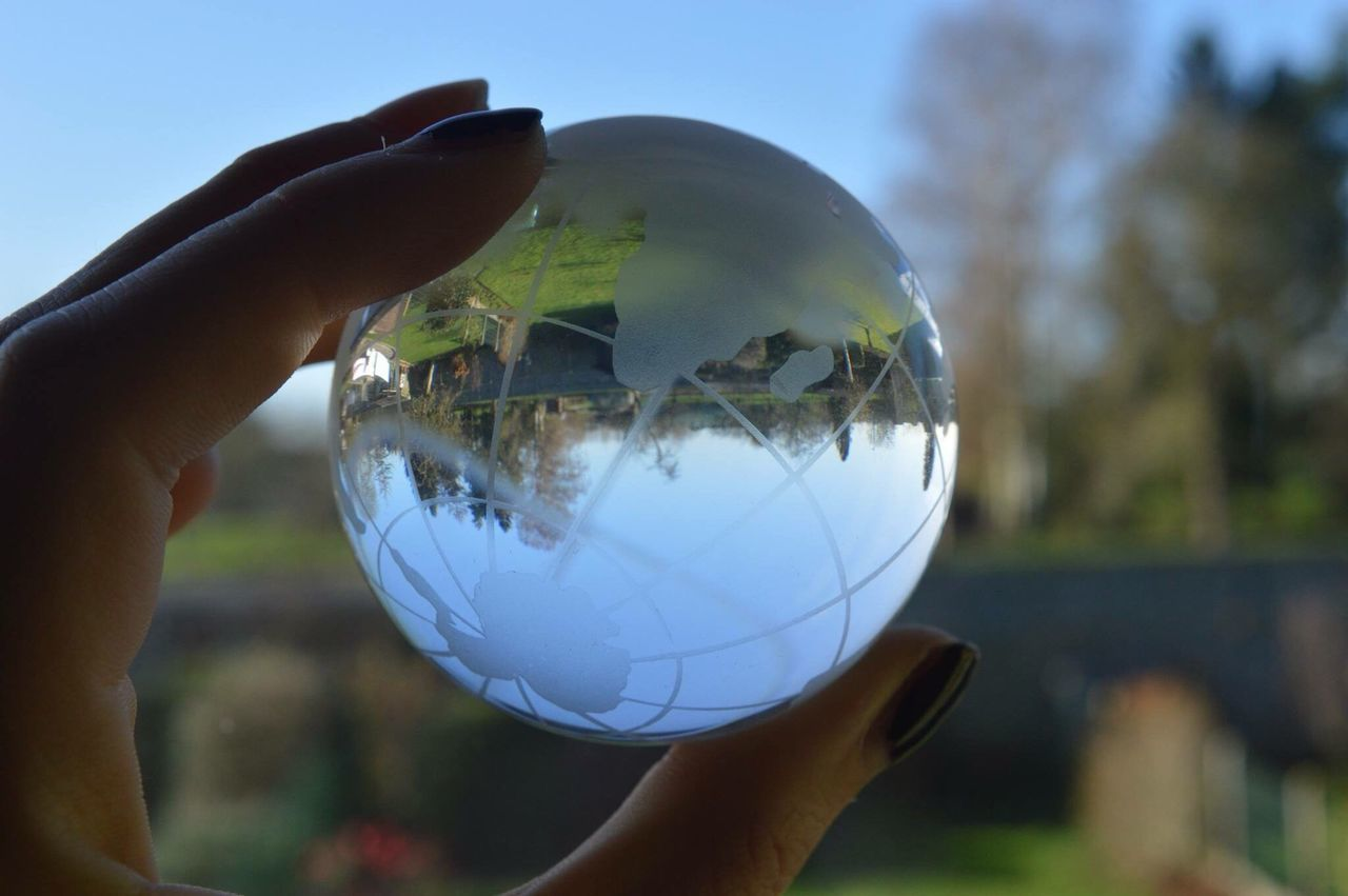 human hand, real people, holding, focus on foreground, close-up, human body part, outdoors, planet earth, day, one person, men, tree, nature, sky, people