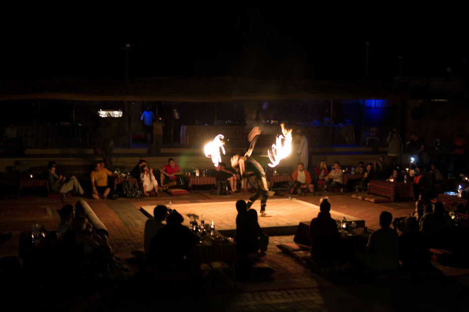 Adults Only Audience Crowd Desert Fire Fire Dance Fire Dancer Fire Show Illuminated Large Group Of People Leisure Activity Night Performance Real People Spectator Vacation Camp