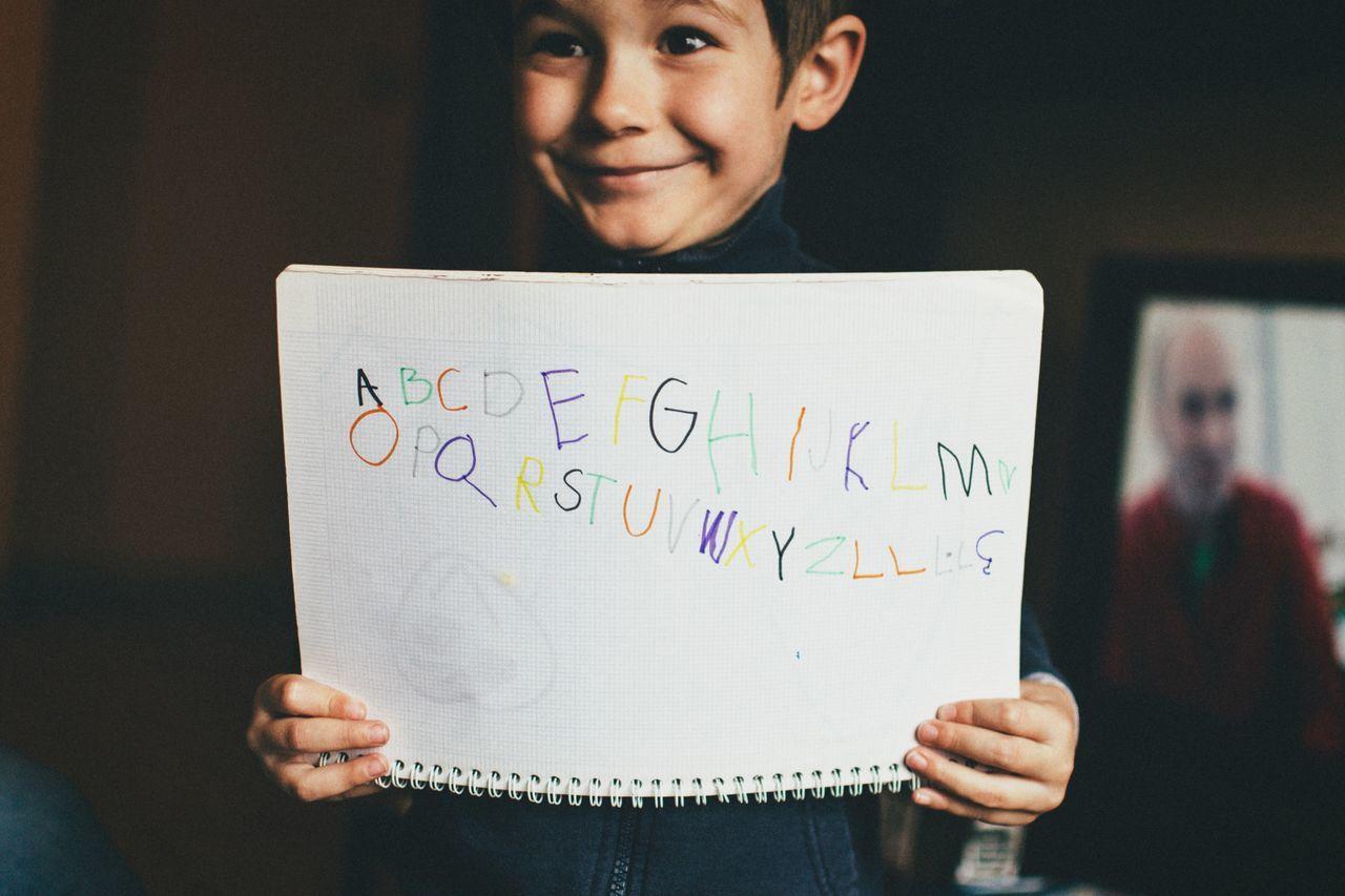 Alphabet & TV news   We Are Family Portrait Boy Studying Enjoying Life Playing Love Alphabetography Family Open Edit
