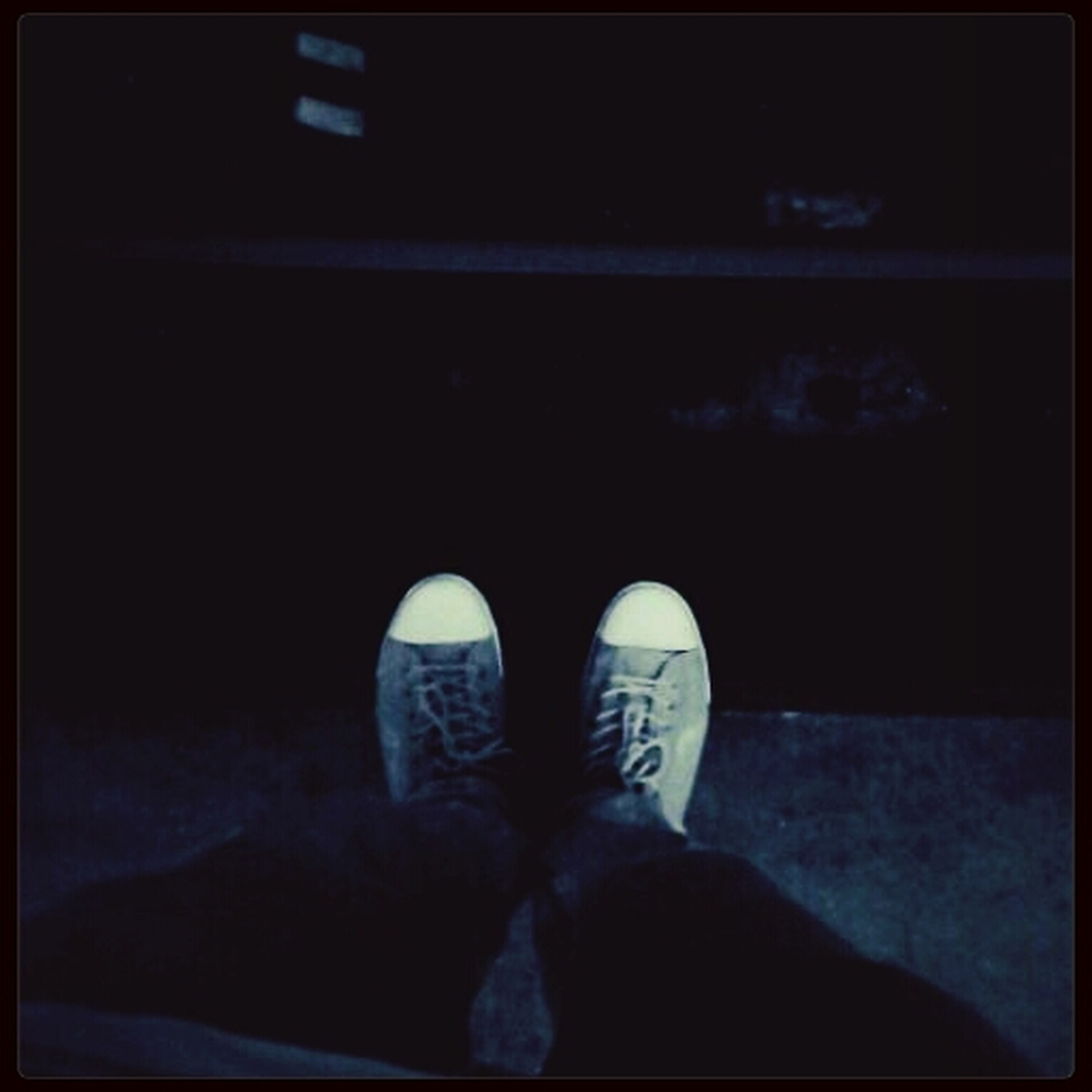 low section, person, lifestyles, transfer print, standing, leisure activity, auto post production filter, shoe, men, rear view, night, personal perspective, casual clothing, human foot, sitting, footwear, relaxation