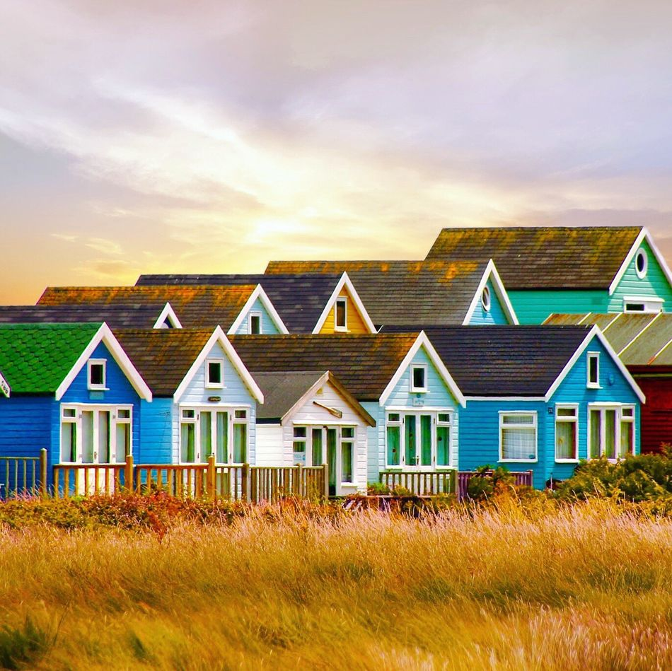 Beach Huts House Built Structure Grass Building Exterior Architecture Sky No People Outdoors Sunset Barn Multi Colored Nature Day