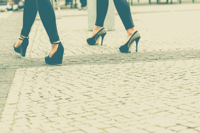 Two young girls walking in high hills shoes Close-up Coturno Crop  High Hill Human Body Part Human Leg Leggins Low Section Permissiveness Pose Presentation Presenting Sexygirl Show Off Togetherness Two People Walkpath Woman WOW Young Adult
