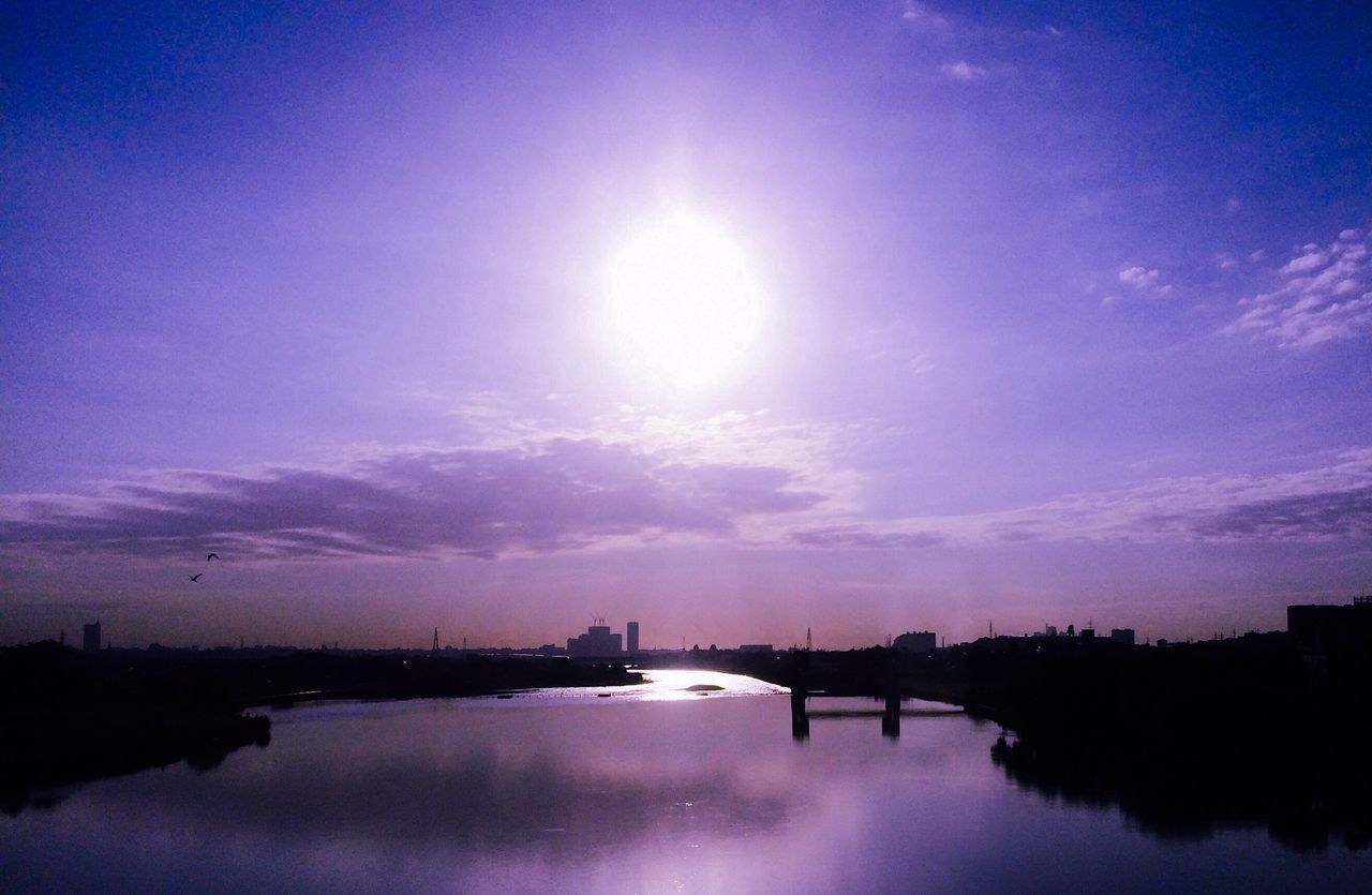 water, sky, river, beauty in nature, reflection, nature, scenics, sun, outdoors, waterfront, no people, tranquil scene, tranquility, sunset, silhouette, building exterior, moon, architecture, day, astronomy