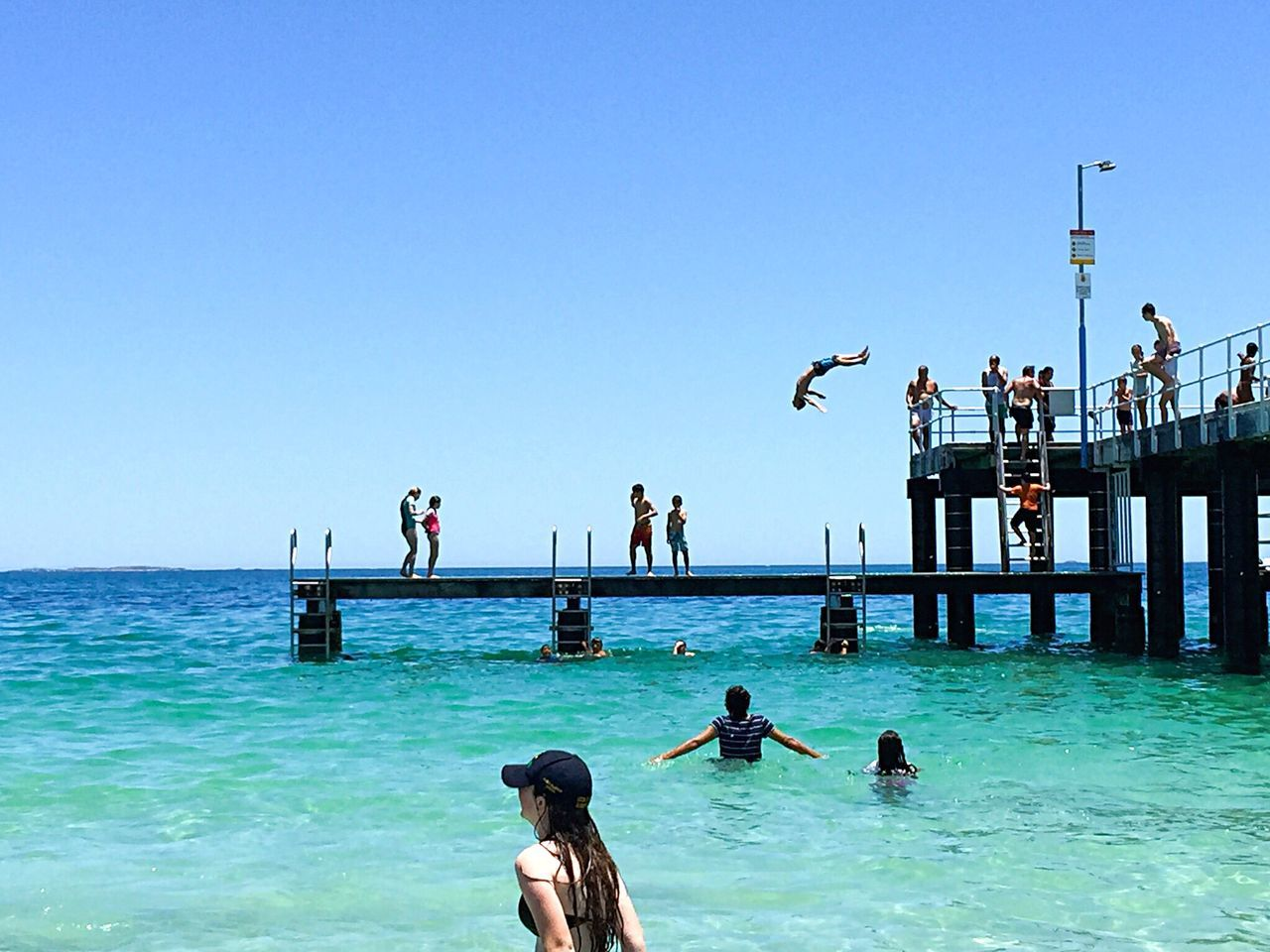Diving Backwards: Jetty Fun Dive Leap Of Faith Fearless Turquoise Water Sea Ocean Indian Ocean Leaping People Families Adrenaline Junkie Thrill Fun Water Fun Jumping Jetty Beach Lifestyle Beach Life Western Australia Beach Beach Photography Australia Summertime Summer Backwards Dive
