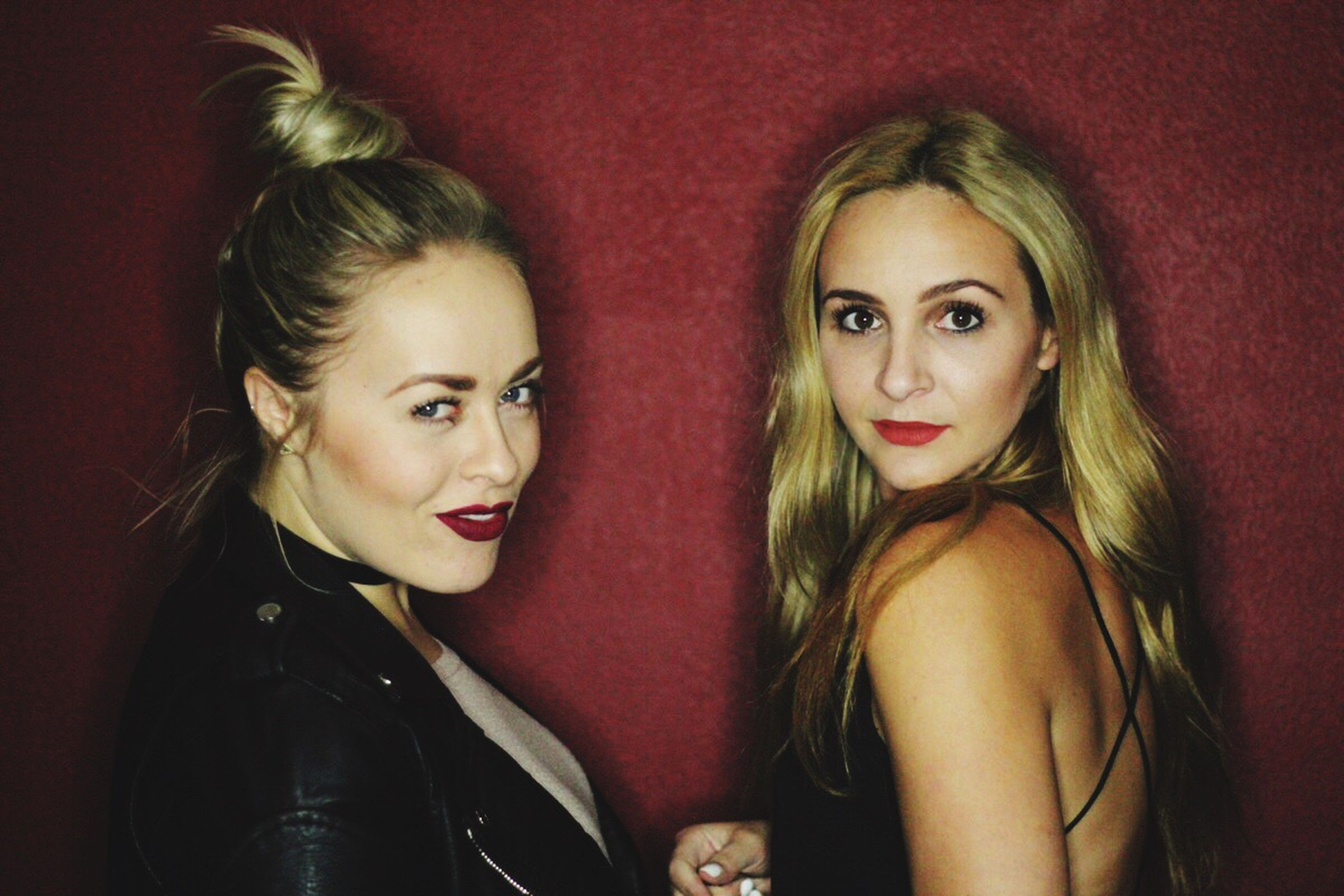 two people, friendship, beautiful people, glamour, fun, portrait, blond hair, red, beauty, make-up, people, nightlife, shiny, adult, nightclub, young adult, ladies' night, city, party - social event, city life, happiness, togetherness, women, beautiful woman, arrival, cheerful, only women, indoors, adults only, red carpet event, human body part