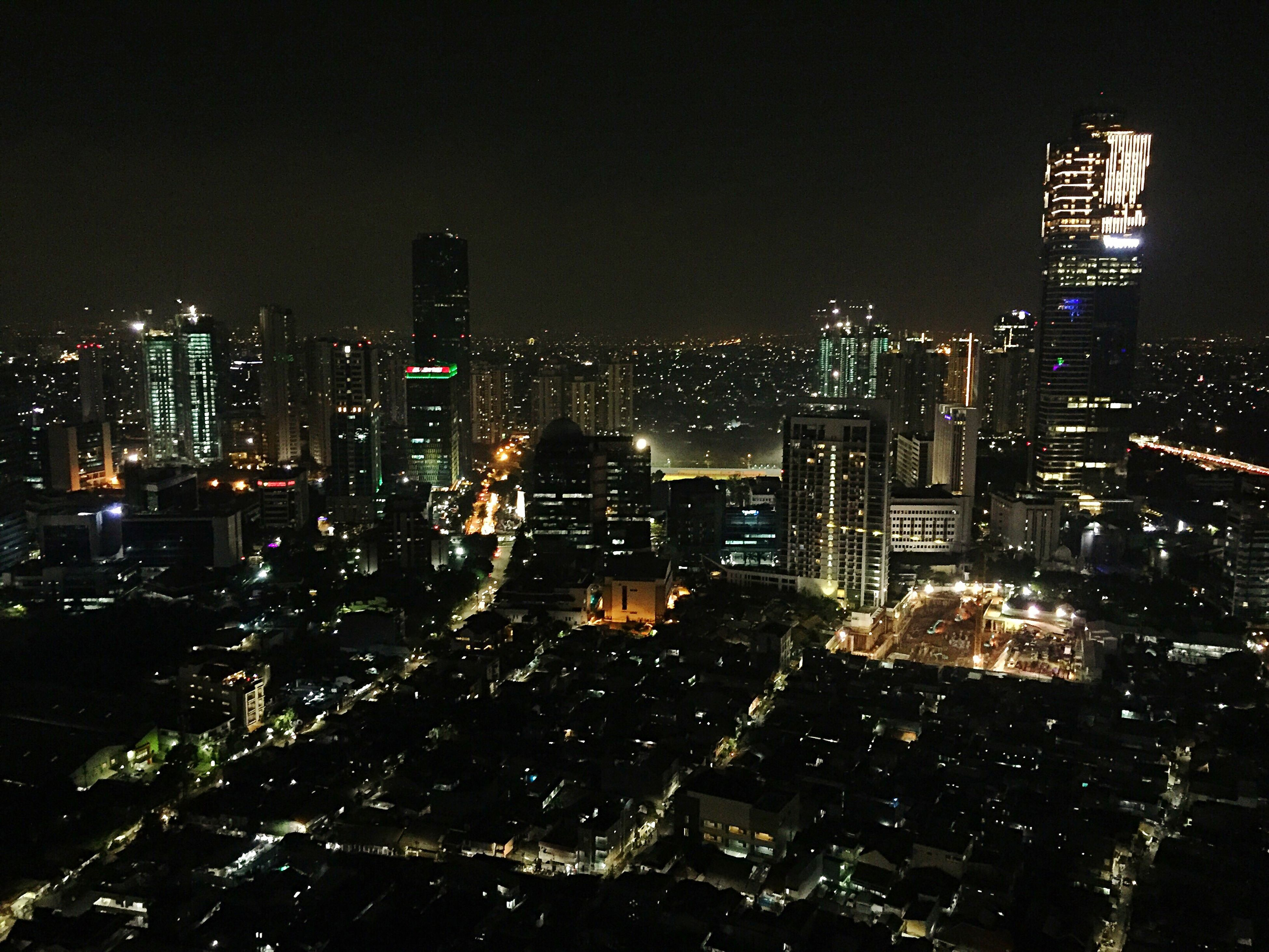 illuminated, cityscape, architecture, skyscraper, night, building exterior, city, modern, growth, built structure, no people, sky, tall, travel destinations, outdoors, clear sky, urban skyline