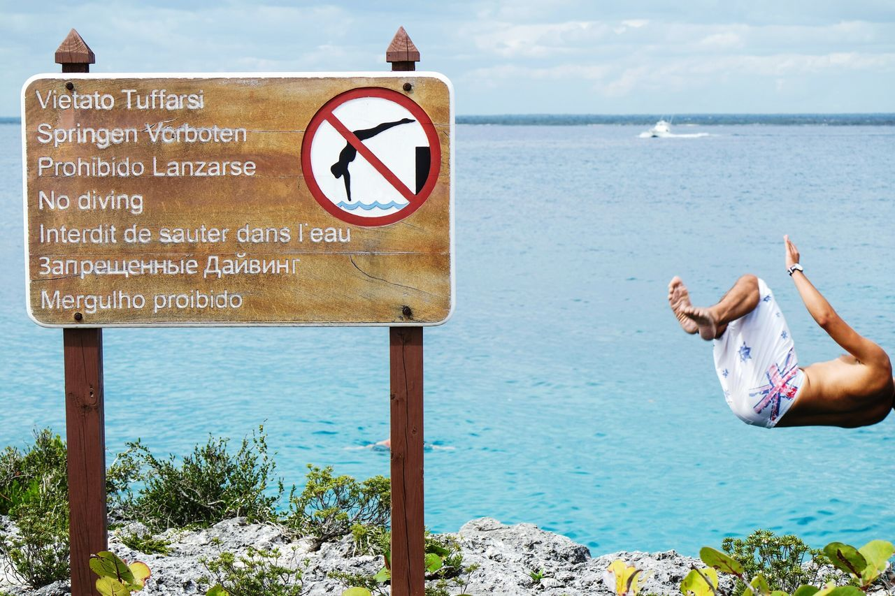 No diving?! Sea Day Human Representation Outdoors Sky Beach Road Sign Water One Person People Horizon Over Water Adult Adults Only Human Body Part Nature EyeEm Best Shots Open Edit Fresh 3 Communication Adult Beauty In Nature Travel Destinations Miles Away Landscape_Collection
