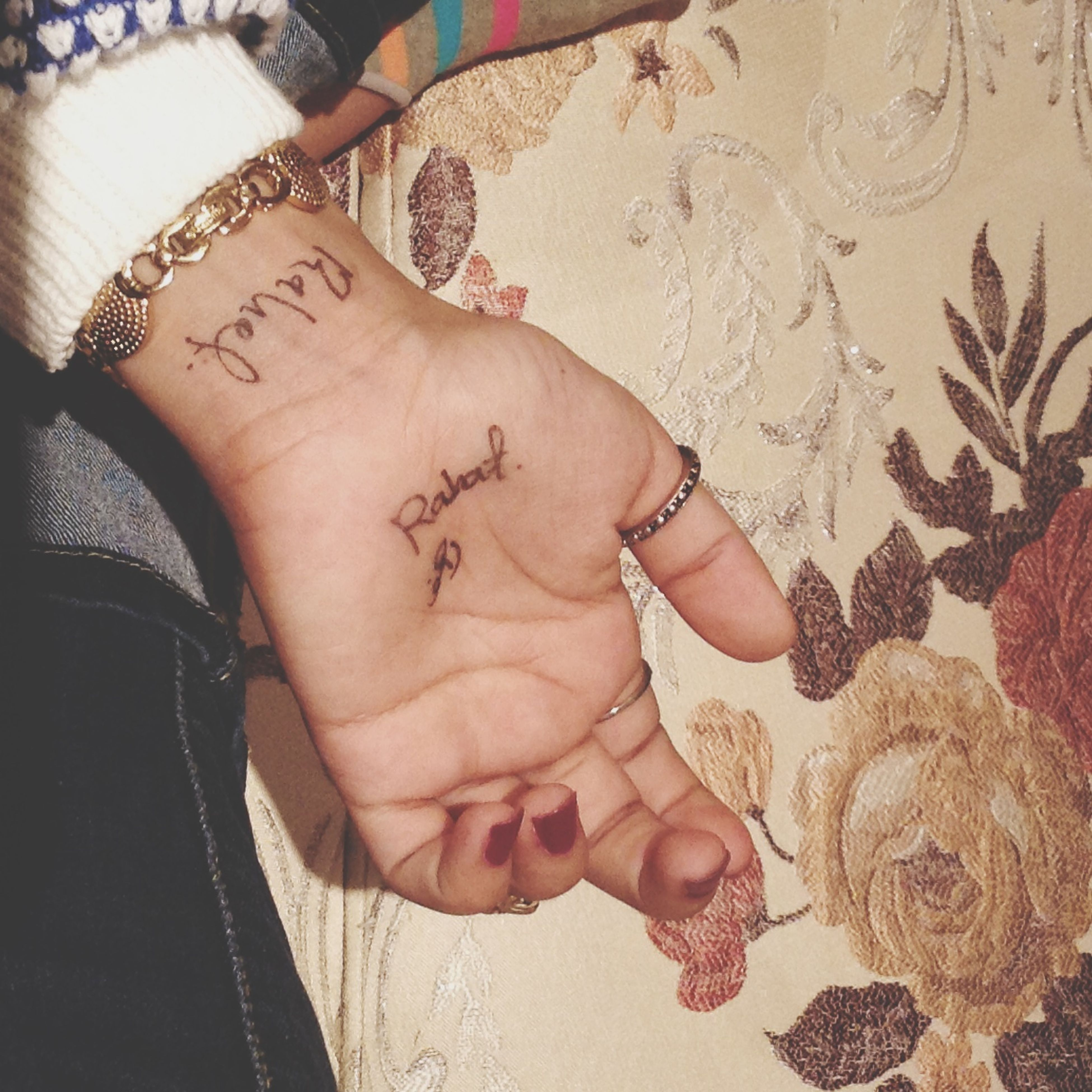 lifestyles, low section, person, indoors, leisure activity, part of, fashion, high angle view, sensuality, femininity, tattoo, close-up, young women, barefoot, human foot