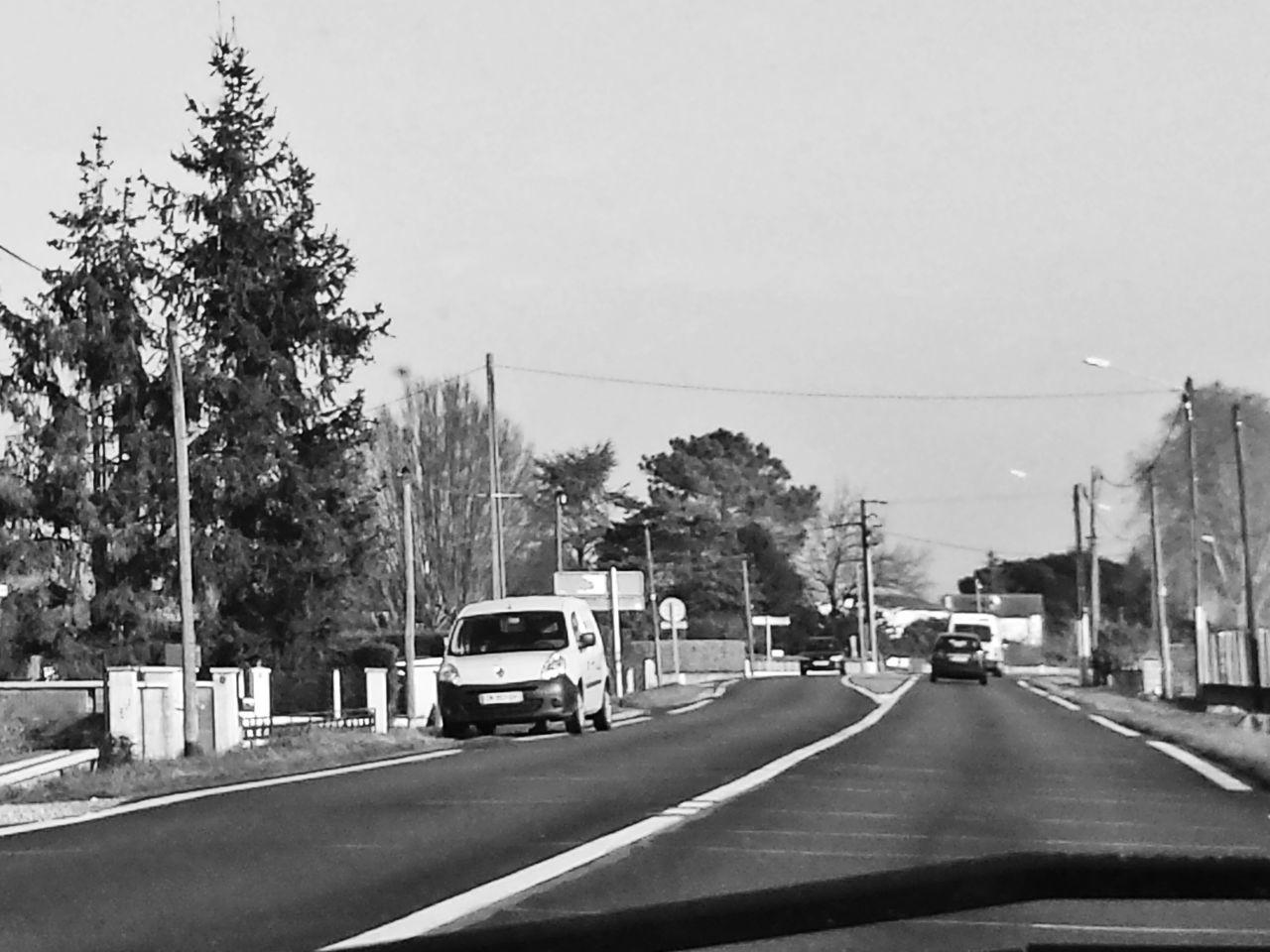 Street Against Clear Sky Seen Through Car Windshield