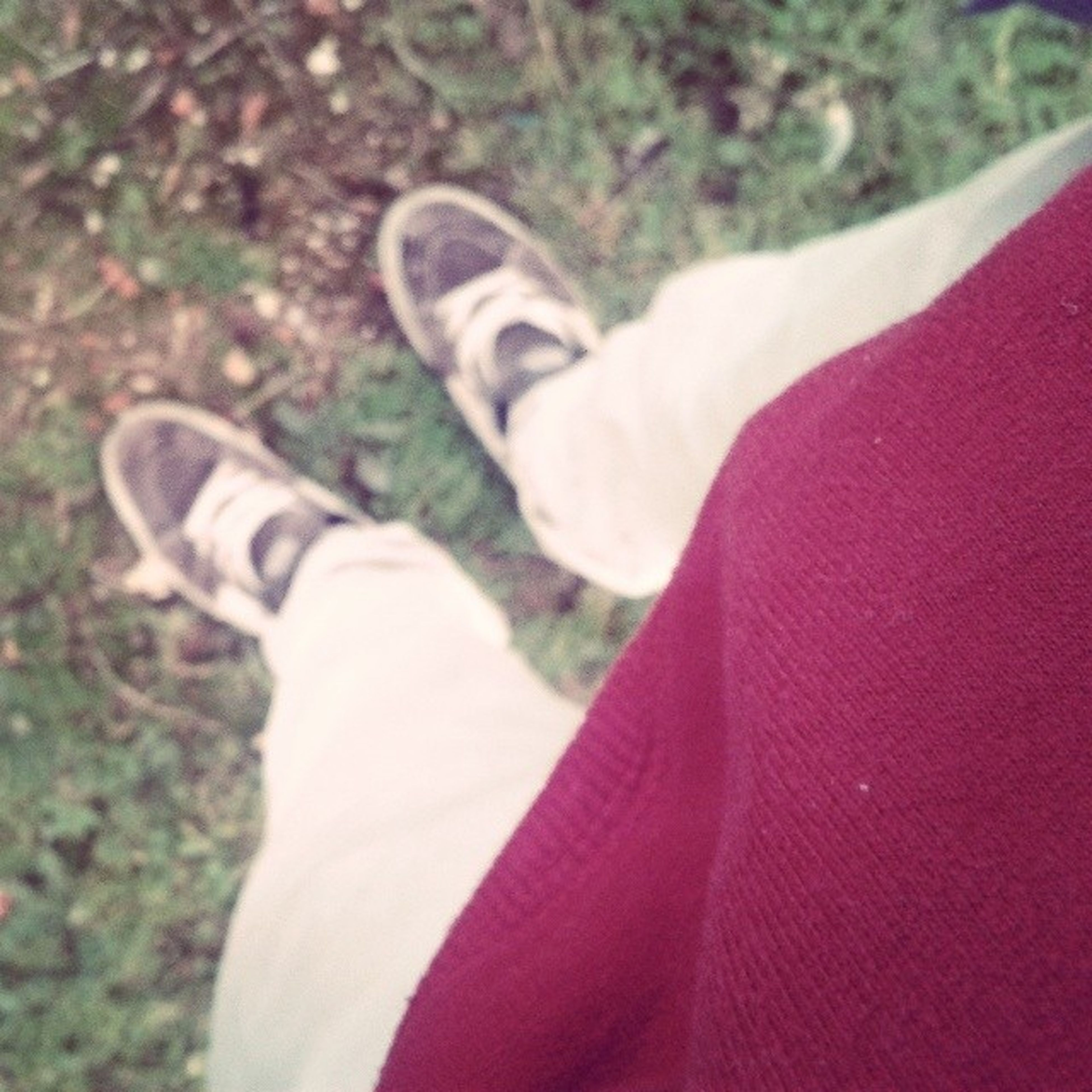 low section, person, personal perspective, lifestyles, leisure activity, shoe, field, standing, jeans, high angle view, focus on foreground, grass, close-up, unrecognizable person, human foot, casual clothing