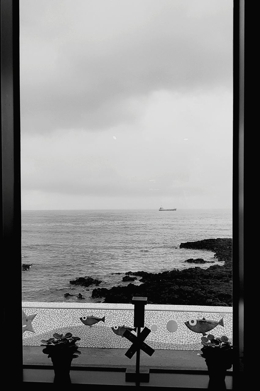 sea, horizon over water, water, sky, day, window, scenics, nature, beauty in nature, no people, tranquility, outdoors, architecture