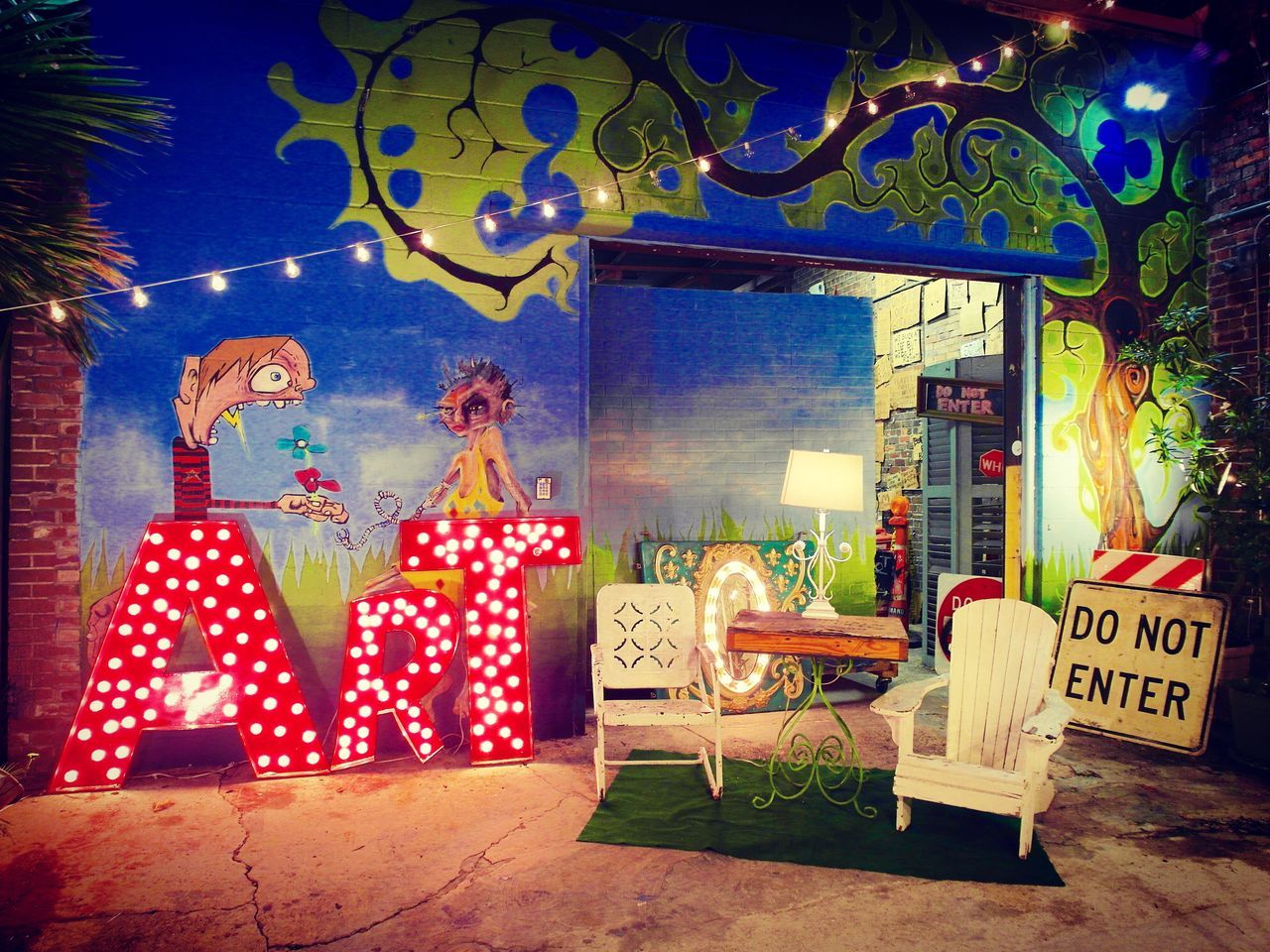 text, western script, communication, night, illuminated, no people, outdoors, building exterior, architecture, tree, neon, sky