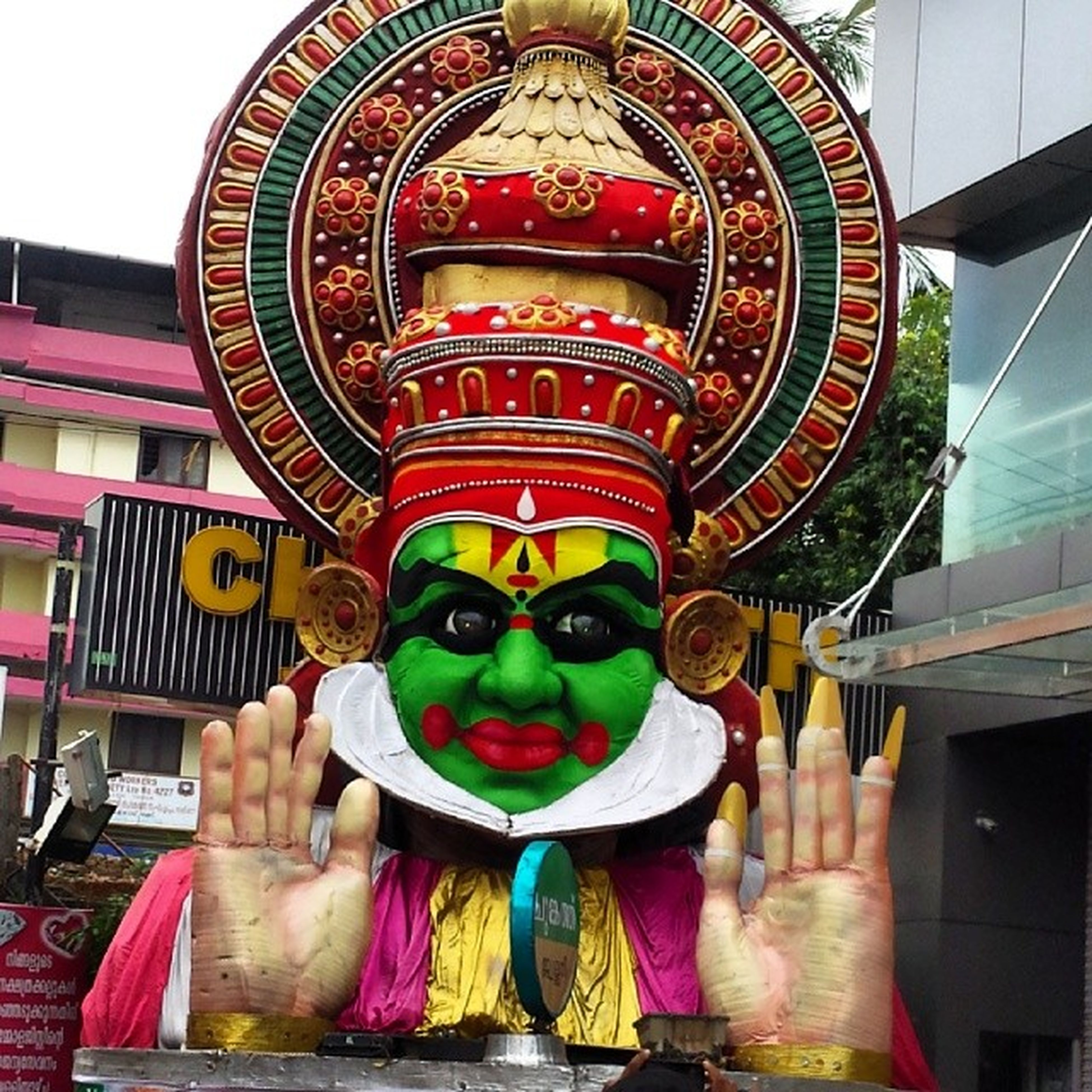 art, architecture, art and craft, built structure, place of worship, creativity, religion, spirituality, human representation, statue, building exterior, sculpture, temple - building, low angle view, multi colored, indoors, animal representation