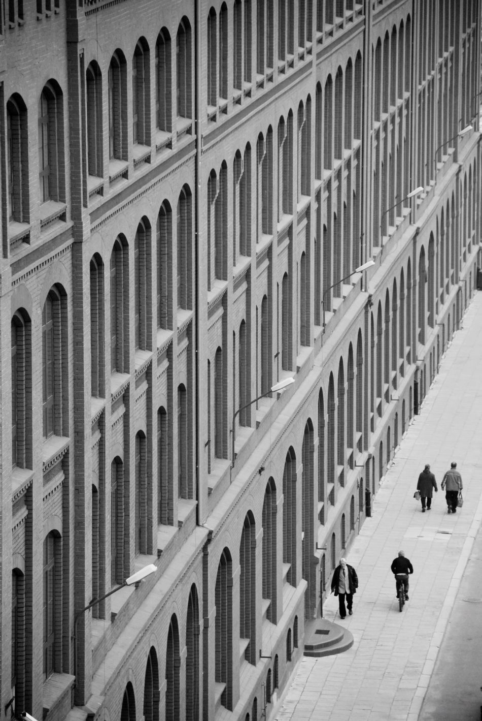 Facade of an old building and small people walking Real People Architecture Built Structure Building Exterior Outdoors Day Arch Façade Facades Facade Building Building Blackandwhite Black And White Perspective Geometry Shape Shapes