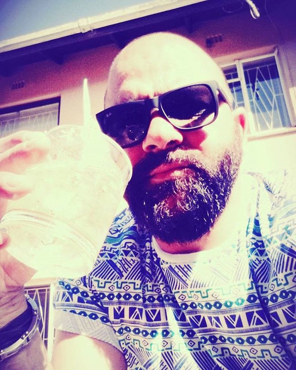 Chilled Braaiday Heritageday IntheCY Beardelegends Bearded Dopandchop Beardlife Beardedlifestyle Beardgang Beardlove Pogonophilenation having a whisky while waiting on the Família