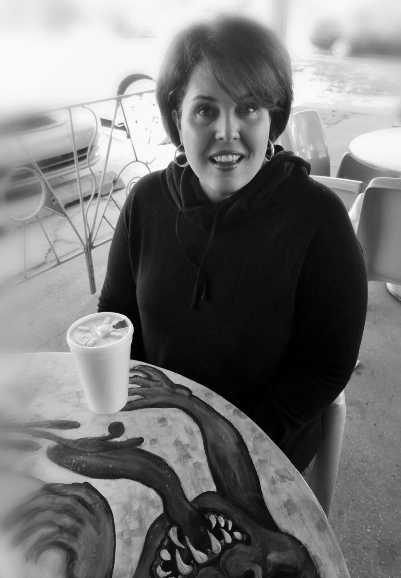 The Greedy Stranger... Black And White Cappuccino ☕️ Coffee Time Day Drink Looking At Camera MUR B&W One Person Outdoors People Portrait Real People Sitting Smiling Woman Portrait Young Adult Young Women The Portraitist - 2017 EyeEm Awards BYOPaper!