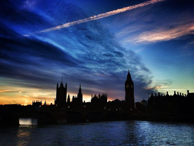 The Sun sets behind the Houses of Parliament