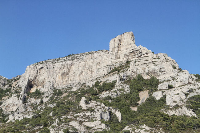 Beauty In Nature Blue Clear Sky Cliff Countryside Eroded Les Goudes , Marseille Les Goudes, Marseille Low Angle View Majestic Mountain Mountain Peak Nature No People Outdoors Remote Rock Rock - Object Rock Formation Rocky Rocky Mountains Scenics Solitude Tranquil Scene Tranquility