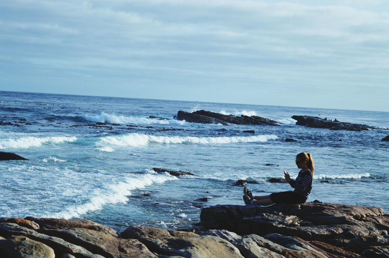 Relaxing Reading Reading A Book Hello World Outdoors The Great Outdoors - 2016 EyeEm Awards Capetown Beach Hanging Out Enjoying Life Blue Sky Taking Photos EyeEm Best Shots Nikon D3200 Sea Blue Sea Potrait Ideal Girl