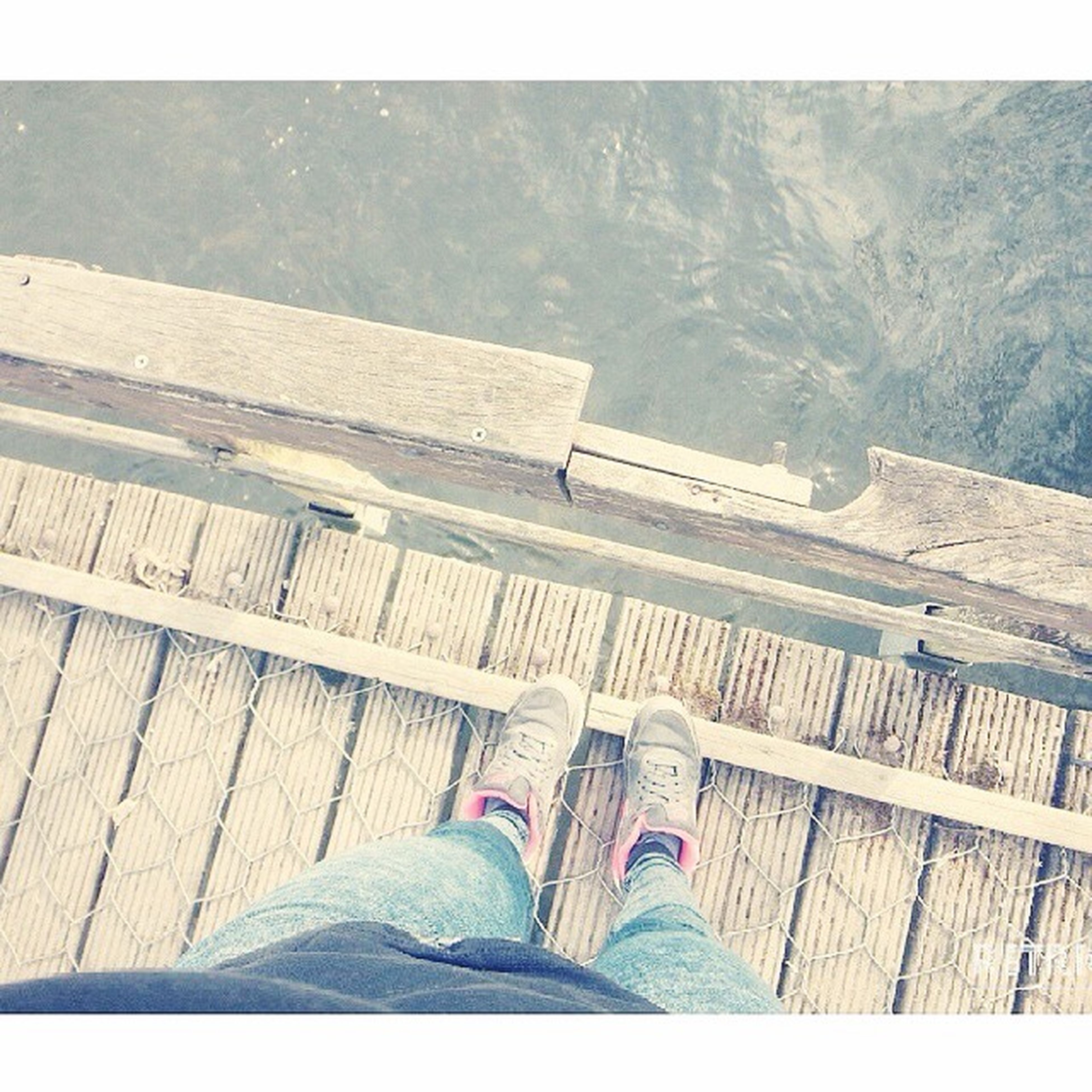 low section, person, personal perspective, shoe, lifestyles, human foot, high angle view, men, standing, leisure activity, footwear, unrecognizable person, relaxation, barefoot, transfer print, wood - material