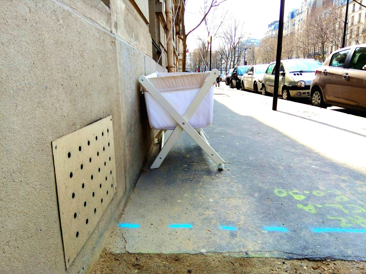 Baby Carriage On Sidewalk By Cars In City