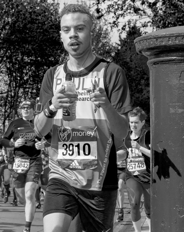 Black & White Casual Clothing Charity Day Focus On Foreground Good Cause Leisure Activity Lifestyles London London Marathon Outdoors Portrait Running Text Thumbs Up Up Close Street Photography