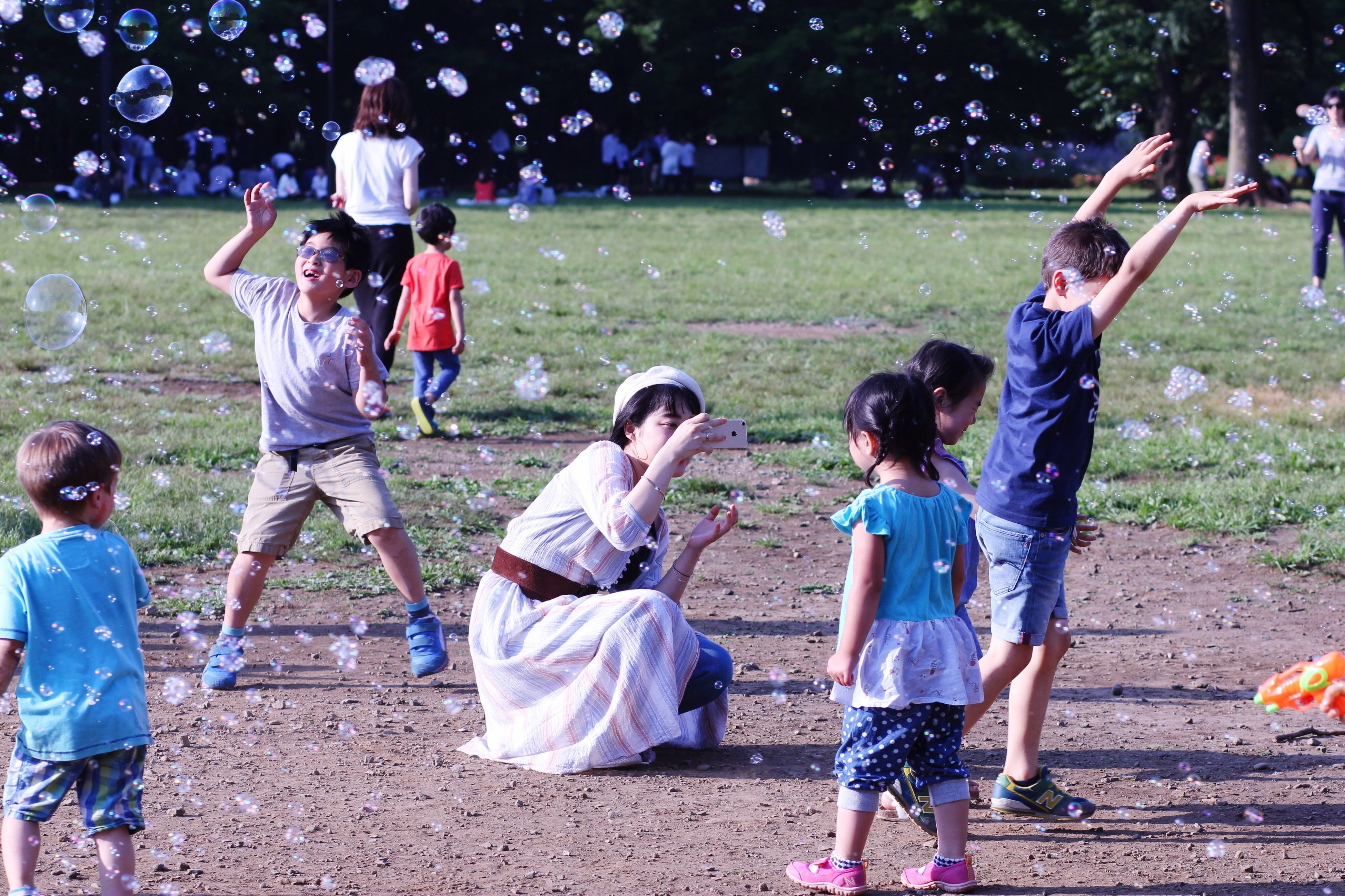 boys, child, childhood, girls, casual clothing, park - man made space, outdoors, playing, day, full length, human body part, happiness, standing, grass, people, adult