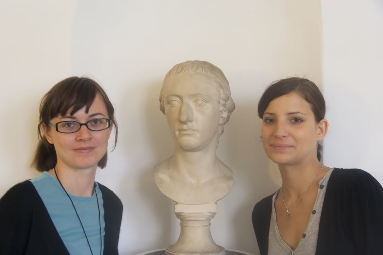 Portrait of two young women with a roman bust in Frankfurt, Germany Ancient Rome Archaeology Bust  Close-up Comparison Cooperation Eyeglasses  German Germany Happy Head And Shoulders Headshot History Indoors  Marble Posing Research Roman Science Sculpture Student Teamwork Two People Women Young Women