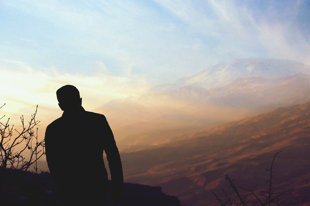 sunset, silhouette, real people, nature, sky, one person, beauty in nature, standing, tranquil scene, men, scenics, tranquility, lifestyles, leisure activity, outdoors, cloud - sky, day, people