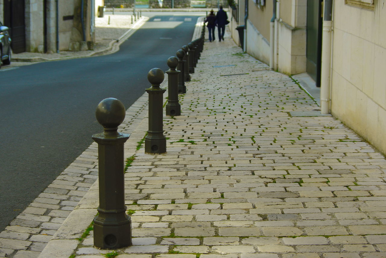 the way forward, cobblestone, in a row, footpath, street, city, architecture, day, built structure, outdoors, travel destinations, road, building exterior, real people