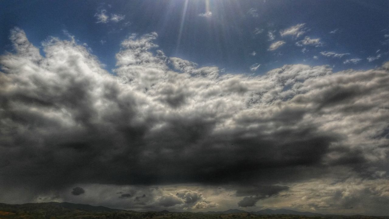 cloud - sky, sky, nature, beauty in nature, weather, sunbeam, scenics, dramatic sky, cloudscape, majestic, low angle view, sky only, no people, tranquility, storm cloud, day, outdoors, backgrounds