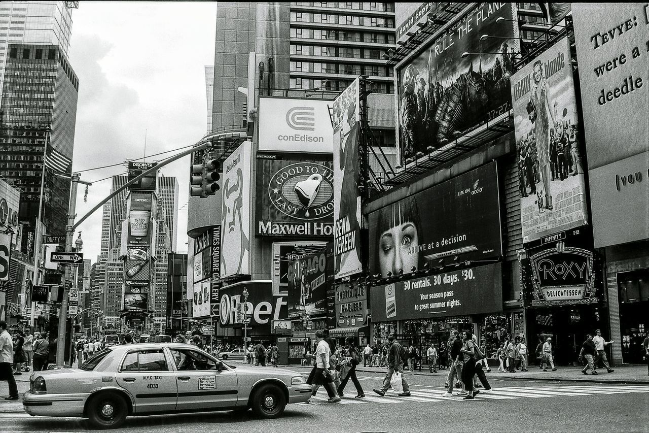 New York City Times Square 2001. New York Street Photography Film Photography Filmisnotdead Film 35mm Film Black And White Photography New York City Blackandwhite Black And White Black & White Streetphotography Street Photography On The Move City Life Times Square NYC Times Square Battle Of The Cities Welcome To Black Neighborhood Map
