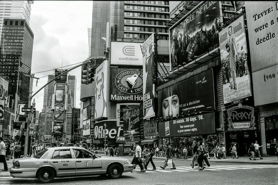 New York City Times Square 2001. New York Street Photography Film Photography Filmisnotdead Film 35mm Film Black And White Photography New York City Blackandwhite Black And White Black & White Streetphotography Street Photography On The Move City Life Times Square NYC Times Square Battle Of The Cities Welcome To Black